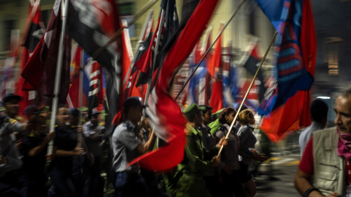 People waving flags take part in a march with torches to mark the 167th anniversary of the birth of Cuba's national independence hero Jose Marti, in Havana, Cuba, Monday, Jan. 27, 2020. (AP Photo/Ramon Espinosa)