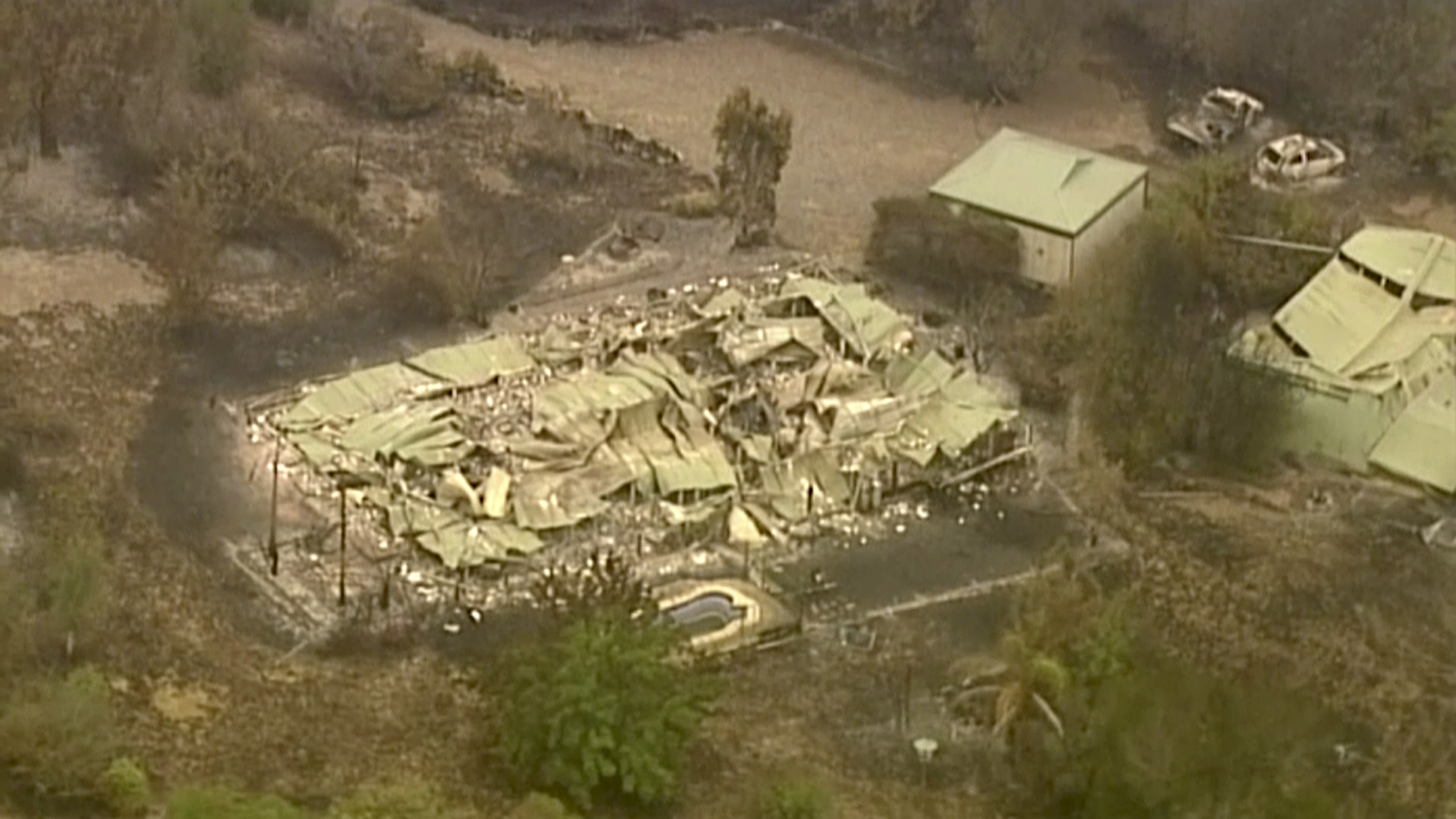In this image made from video, an aerial scene shows destroyed properties after a wildfire in East Grippsland, Victoria, Wednesday, Jan. 1, 2020. Australia deployed military ships and aircraft to help communities ravaged by apocalyptic wildfires that destroyed homes and sent thousands of residents and holidaymakers fleeing to the shoreline.(Australian Broadcasting Corporation, Channel 7, Channel 9 via AP)