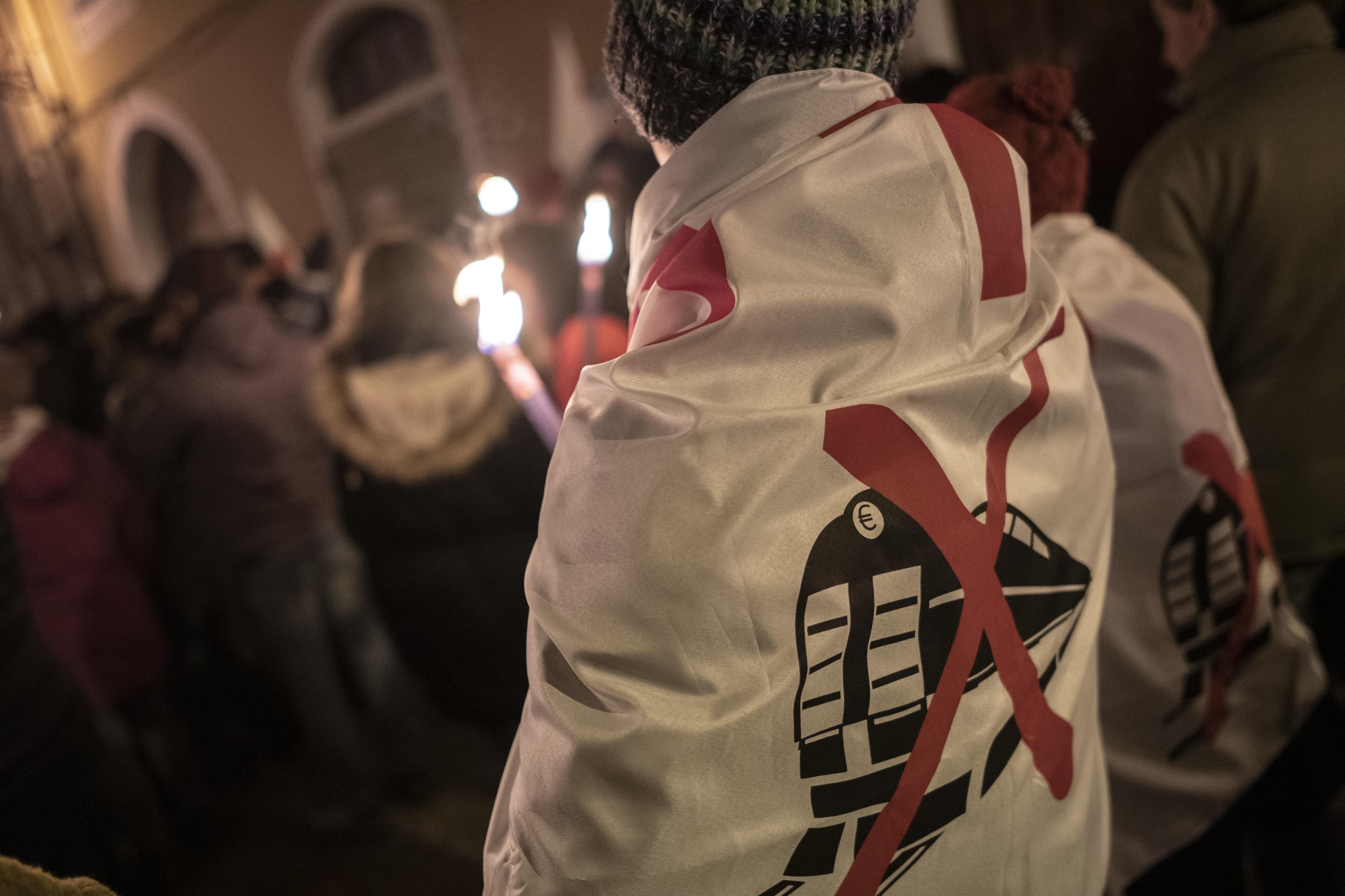 Foto Marco Alpozzi/LaPresse  01 Gennaio 2020 Bussoleno, Italia  Cronaca Il movimento NoTav a Bussoleno scende in piazza per una fiaccolata di solidarietà per Nicoletta Dosio, l'attivista di 73 anni portata in carcere il 30 Dicembre  Nella foto:  un momento del corteo  Photo Marco Alpozzi/LaPresse  Jenuary 01, 2020 Bussoleno, Italy  News The NoTav movement in Bussoleno solidarity torchlight procession for Nicoletta Dosio, the 73-year-old activist taken to prison on 30 December In the pic: NoTac activist during torchlight procession