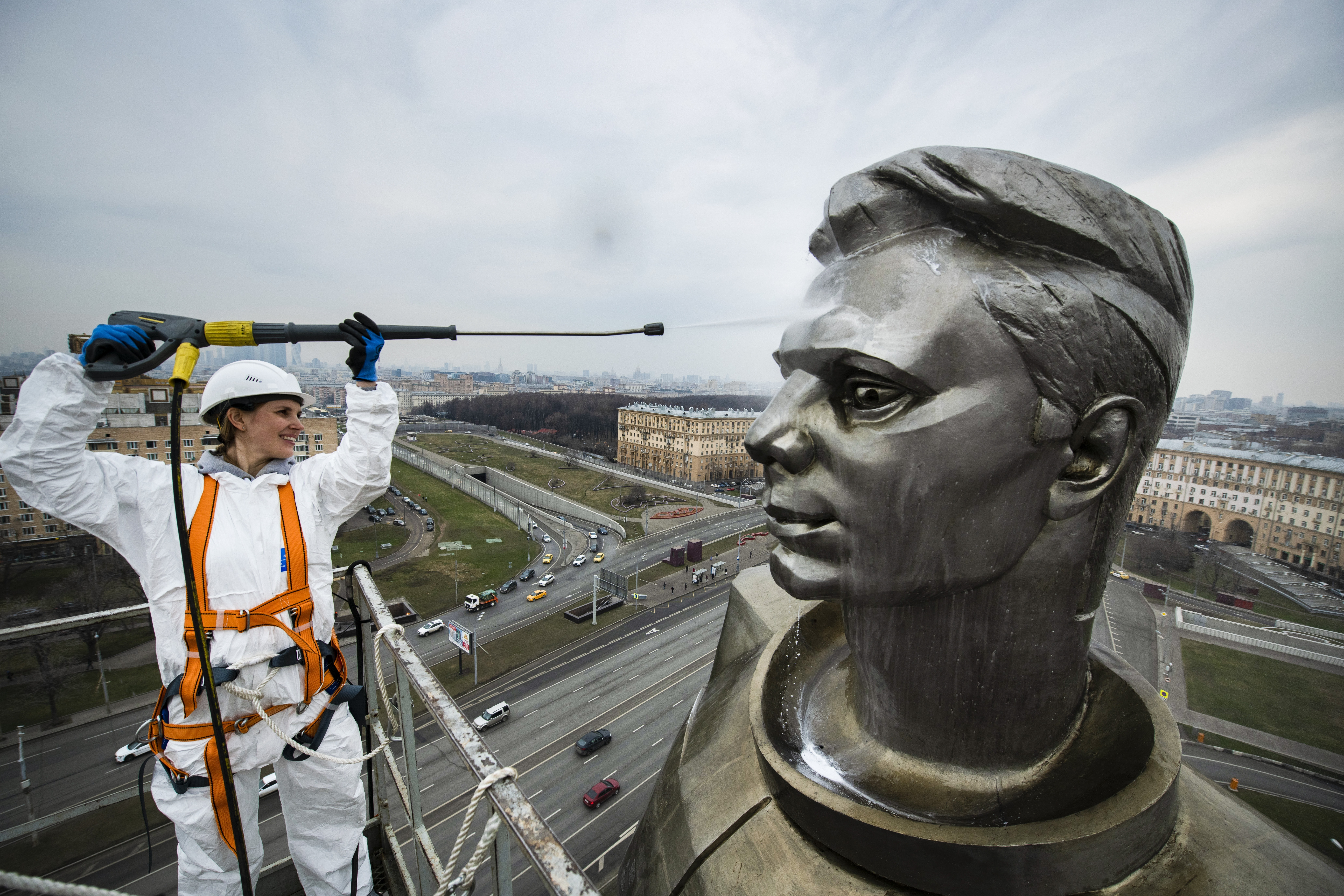 A worker cleans the statue of Yuri Gagarin, the first person who flew to space, ahead of Cosmonautics Day celebrated on April 12, in Moscow, Russia, Wednesday April 10, 2019. Cosmonautics Day marks when Soviet cosmonaut Yuri Gagarin became the first man to fly in space, in 1961, orbiting the earth once before making a safe landing. (AP Photo/Maxim Marmur)