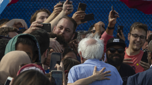 A supporter hugs Democratic presidential candidate Sen. Bernie Sanders, I-Vt., as he signs autographs at a campaign event at Valley High School in Santa Ana, Calif., Friday, Feb. 21, 2020. (AP Photo/Damian Dovarganes)