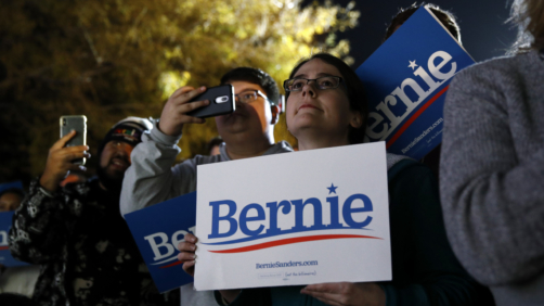 Attendees listen during a campaign event for Democratic presidential candidate Sen. Bernie Sanders, I-Vt., at Springs Preserve in Las Vegas, Friday, Feb. 21, 2020. (AP Photo/Patrick Semansky)