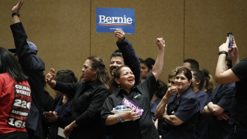 Supporters of Democratic presidential candidate Sen. Bernie Sanders, I-Vt., cheer as they caucus at the Bellagio hotel-casino, Saturday, Feb. 22, 2020, in Las Vegas. (AP Photo/John Locher)