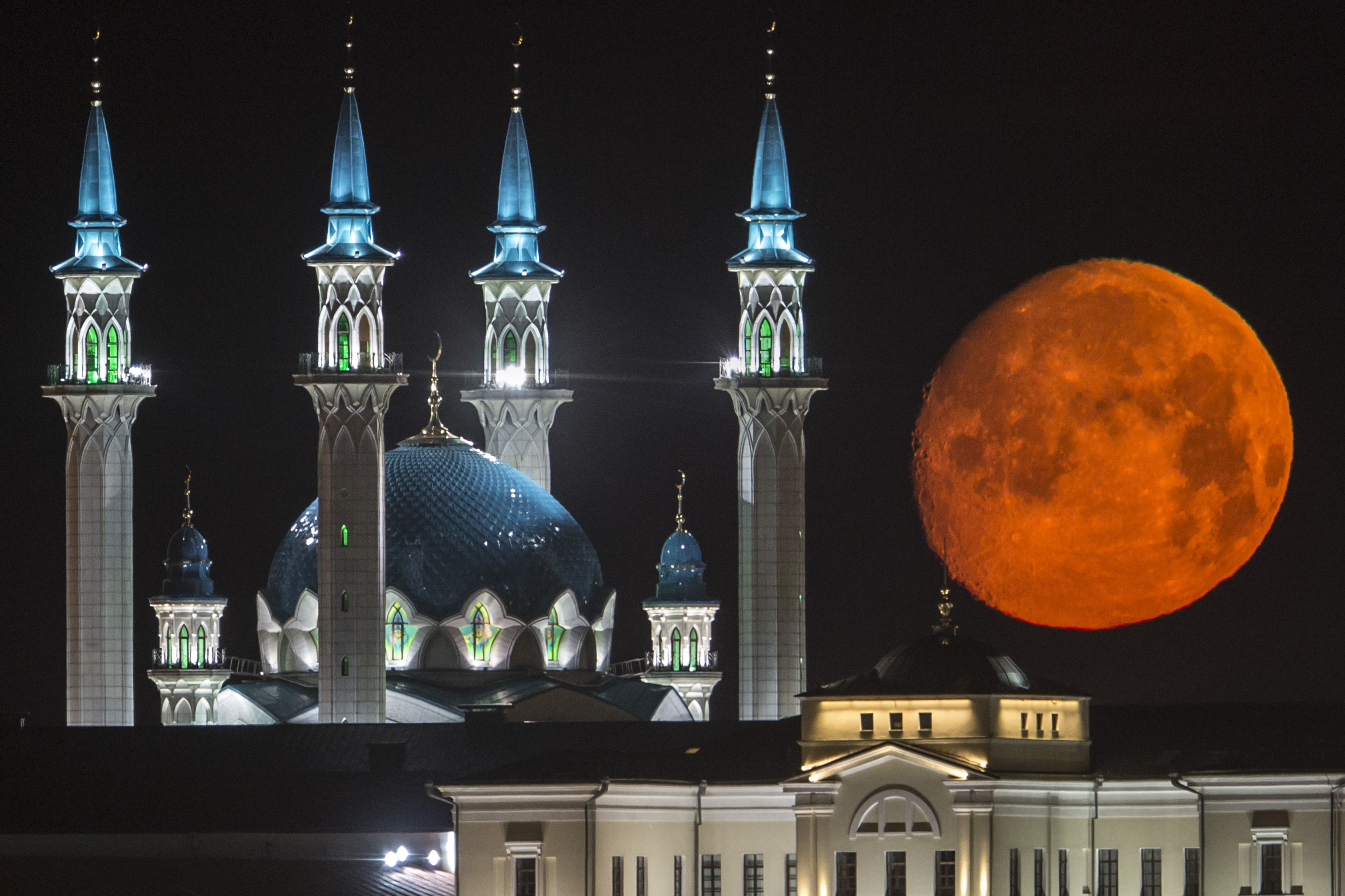 AP10ThingsToSee - The full moon rises over the illuminated Kazan Kremlin with the Qol Sharif mosque illuminated in Kazan, the capital of Tatarstan, located in Russia's Volga River area about 700 km (450 miles) east of Moscow, early Wednesday, July, 29, 2015. (AP Photo/Denis Tyrin)
