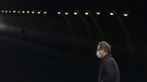 A man wears a mask while crossing in front of the Stockton Street Tunnel in San Francisco, Sunday, March 29, 2020. Californians endured a weekend of stepped-up restrictions aimed at keeping them home as much as possible while hospitals and health officials scrambled Sunday to ready themselves for a week that could see the feared dramatic surge in coronavirus cases. (AP Photo/Jeff Chiu)