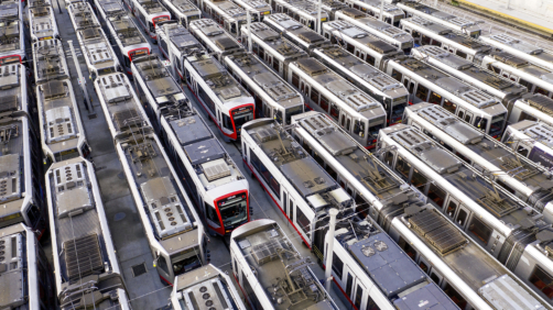 Muni light rail cars rest dormant at a Geneva Ave. storage and maintenance facility on Monday, March 30, 2020, in San Francisco. On Monday, San Francisco Municipal Transportation Agency (SFMTA) indefinitely suspended all light rail service due to plummeting readership caused by coronavirus shelter-in-place orders. (AP Photo/Noah Berger)