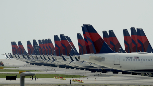 Several dozen mothballed Delta Air Lines jets are parked at Kansas City International Airport Wednesday, April 1, 2020 in Kansas City, Mo. The planes are among the thousands of passenger jets taken out of service worldwide as travel restrictions and stay-at-home orders due to the new coronavirus has drastically reduced air travel. (AP Photo/Charlie Riedel)
