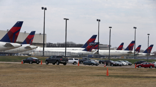 Delta Air Lines planes sit idle at a hangar at Minneapolis-St. Paul International Airport, Thursday, April 2, 2020, as the coronavirus continues to spread. (AP Photo/Jim Mone)