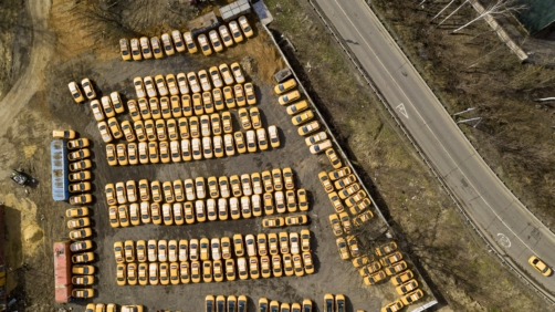 A taxi park full of parked cars due to lack of orders is viewed from a drone taken on the outskirts of Moscow, Russia, Sunday, April 5, 2020. President Vladimir Putin on Thursday ordered most Russians to stay off work until the end of the month as part of a partial economic shutdown to curb the spread of the coronavirus. The new coronavirus causes mild or moderate symptoms for most people, but for some, especially older adults and people with existing health problems, it can cause more severe illness or death. (AP Photo/Maxim Marmur)