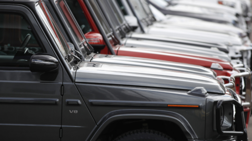 In this Sunday, April 5, 2020, photograph, a long row of unsold 2020 G63 sports-utility vehicles sits at a Mercedes Benz dealership in Littleton, Colo. (AP Photo/David Zalubowski)