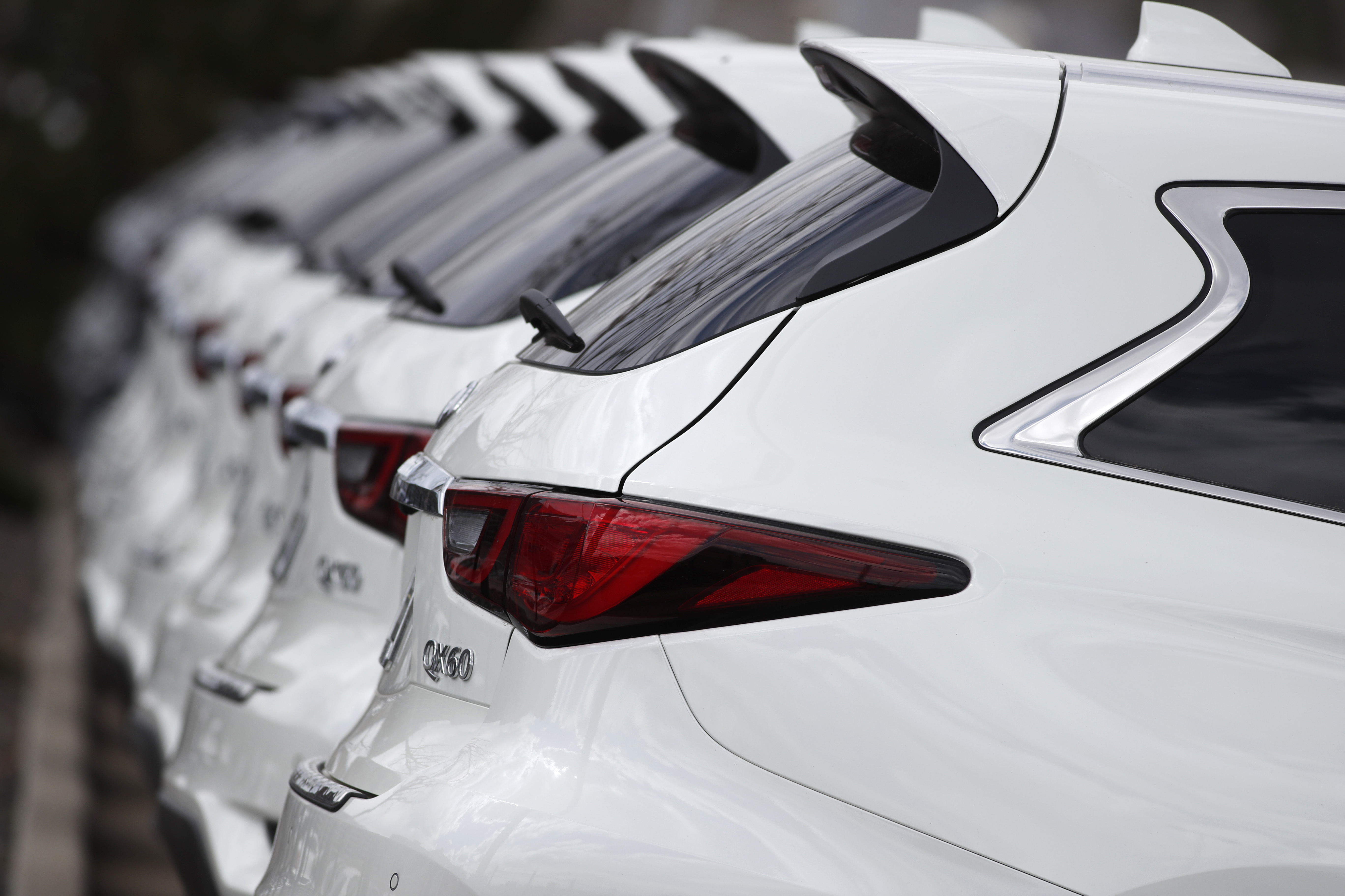 In this Sunday, April 5, 2020, photograph, a long row of 2020 QX60 sports-utility vehicles sits at an Infinti dealership in Highlands Ranch, Colo. (AP Photo/David Zalubowski)
