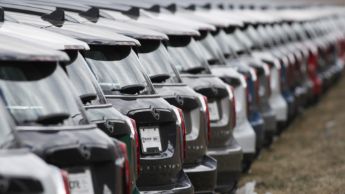 In this Sunday, April 5, 2020, photograph, a long row of unsold 2020 Countryman sports-utility vehicles sits at a Mini dealership in Highlands Ranch, Colo. (AP Photo/David Zalubowski)
