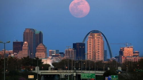 The pink supermoon rises over St. Louis on Tuesday, April 7, 2020. April's supermoon is the brightest and largest it will be for all of 2020. (David Carson/St. Louis Post-Dispatch via AP)