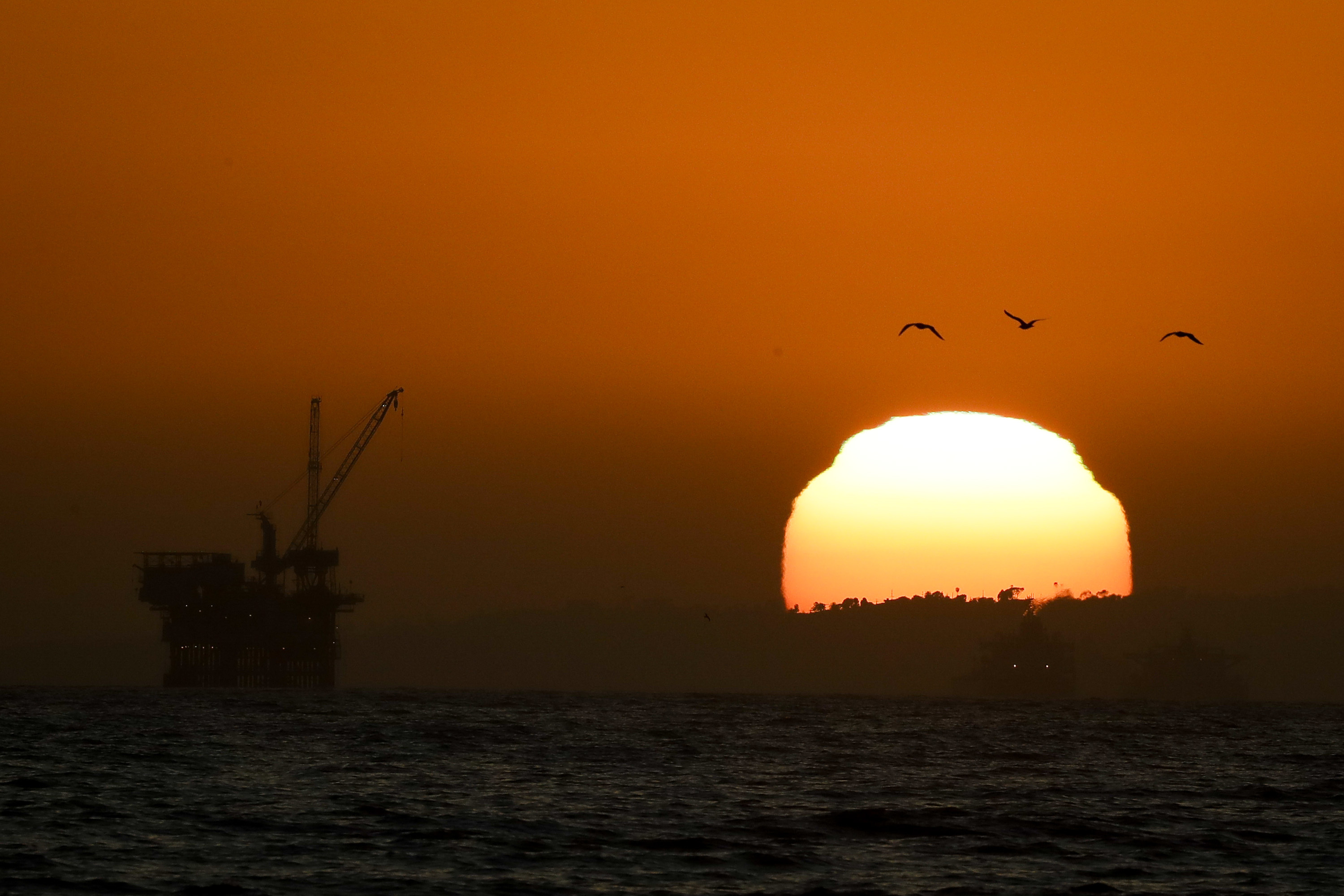 Offshore oil drilling platforms are seen Tuesday, April 21, 2020, in Huntington Beach, Calif. Oil prices continue to drop, because very few people are flying or driving, and factories have shut amid widespread stay-at-home orders due to the coronavirus concerns. (AP Photo/Chris Carlson)