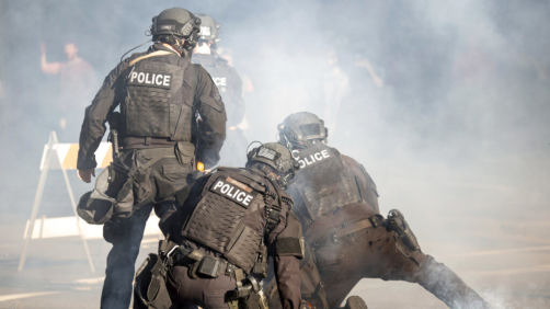 Police take down a protester in Spokane, Wash. on May 31, 2020, during a protest over the death of George Floyd on May 25.. (Libby Kamrowski/The Spokesman-Review via AP)