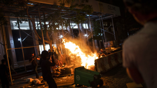 Protesters start fires along the SoHo shopping district on Sunday, May 31, 2020, in New York. Protests were held throughout the city over the death of George Floyd, a black man in police custody in Minneapolis who died after being restrained by police officers on Memorial Day. (AP Photo/Wong Maye-E)