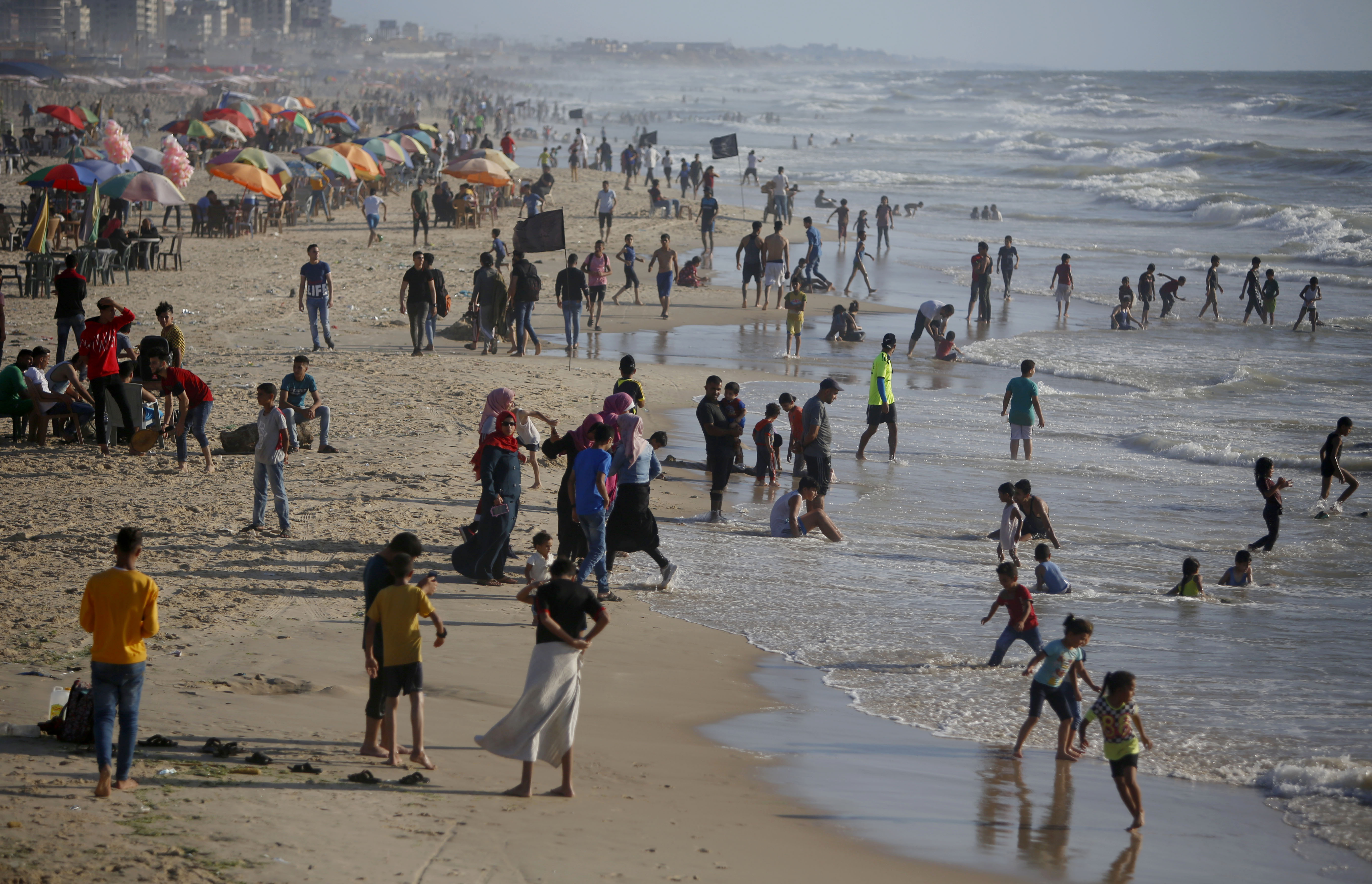 Palestinians enjoy the beach of the Mediterranean sea in Gaza City, Friday, June 19, 2020. The beach is one of the few open public spaces in this densely populated city. (AP Photo/Hatem Moussa)