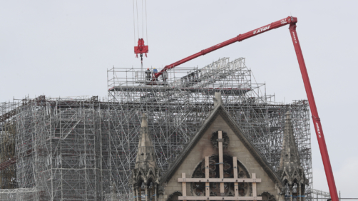 Workers start removing the scaffolding at Notre Dame cathedral, Monday, June 8, 2020 in Paris. Workers suspended from ropes will be lowered into the charred remains of scaffolding that melted atop Notre Dame when the cathedral went up in flames and begin the delicate job of dismantling the 200 tons of metal. (AP Photo/Thibault Camus)