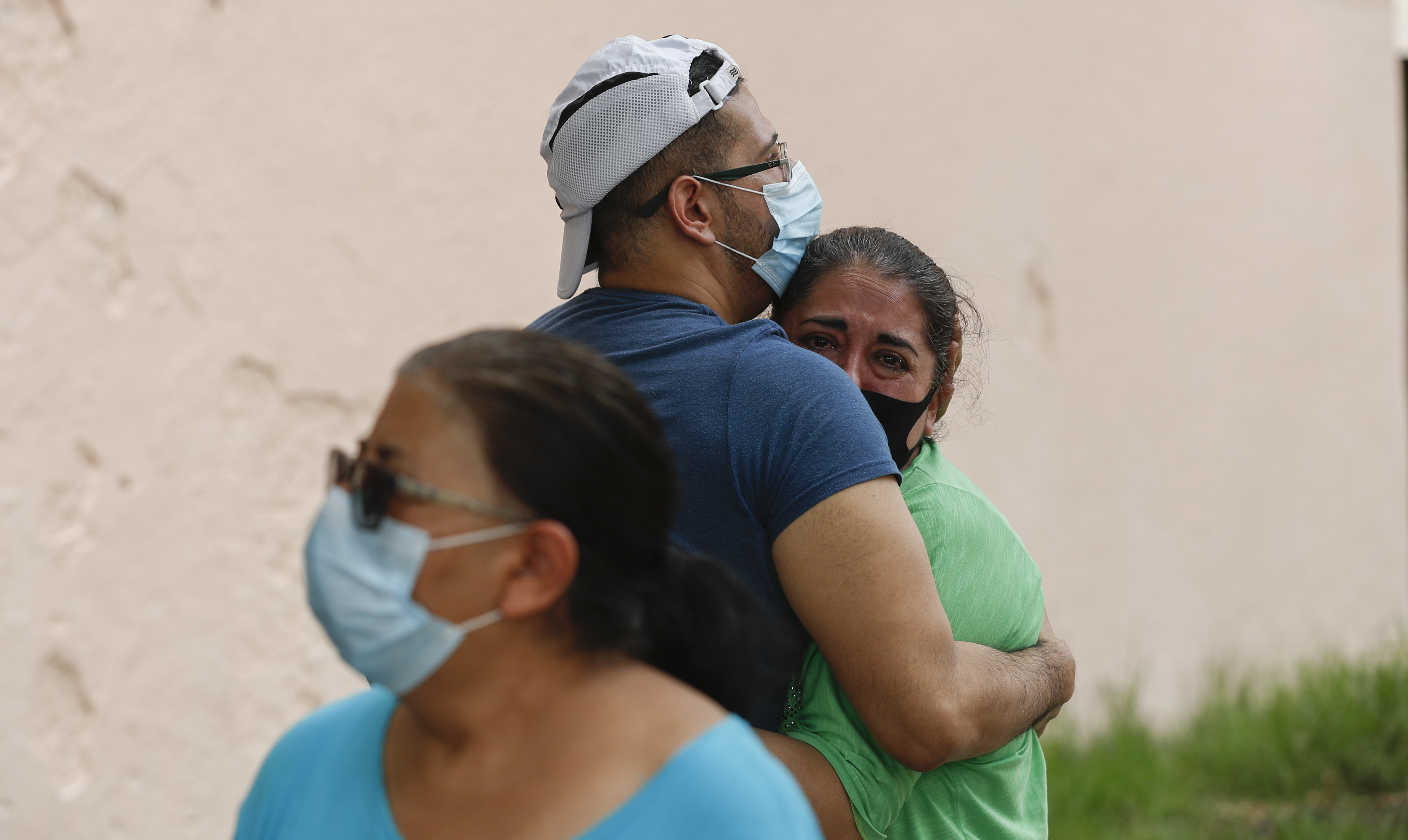 A couple embraces outside their home as they wait for the all-clear to return to their apartment, after an earthquake in Mexico City, Tuesday, June 23, 2020. The earthquake struck near the Huatulco resort in southern Mexico on Tuesday morning, swayed buildings in Mexico City and sent thousands fleeing into the streets. (AP Photo/Eduardo Verdugo)