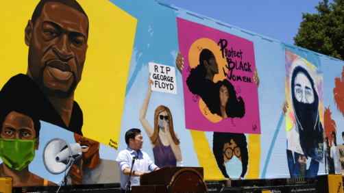 Los Angeles Fourth District Councilmember David Ryu talks at the unveiling of a 148-foot tribute mural to Black Lives Matter in Los Angeles on Tuesday, July 7, 2020. The artwork was created by five African American artists, Alexandra Allie Belisle, Amanda Ferrell Hale, Noah Humes, PeQue Brown, and Shplinton. Said to be the largest in the nation the mural was commissioned by Ryu and the Laugh Factory. (AP Photo/Richard Vogel)