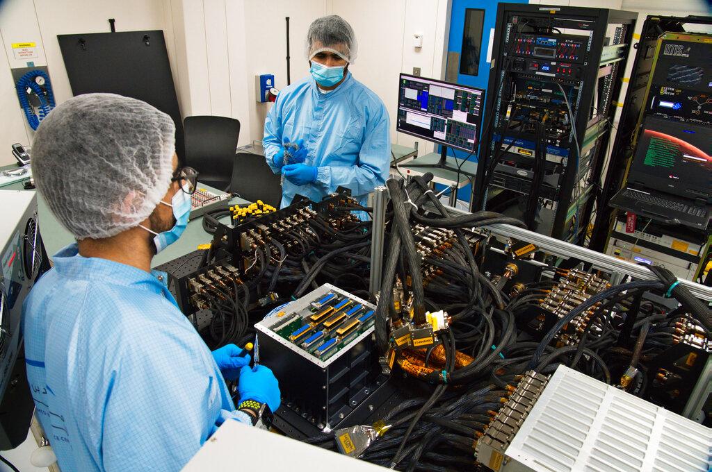 Mahmood al-Nasser, left, and Mohammad Nasser al-Emadi, center, test the Emirates Mars Mission probe's