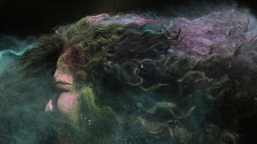 A woman's hair is smeared with colored powder during celebrations marking the Holi festival in Mumbai, India, Tuesday, March 10, 2020. Holi, the festival of colors heralds the arrival of spring (AP Photo/Rajanish Kakade)
