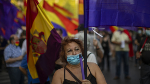 Demonstrators march during a protest against Spanish Monarchy in Madrid, Spain, Saturday, July 25, 2020. A barrage of media leaks have revealed how the king's father, former monarch Juan Carlos I, allegedly hid millions of untaxed euros in offshore funds, prompting public protests. (AP Photo/Manu Fernandez)