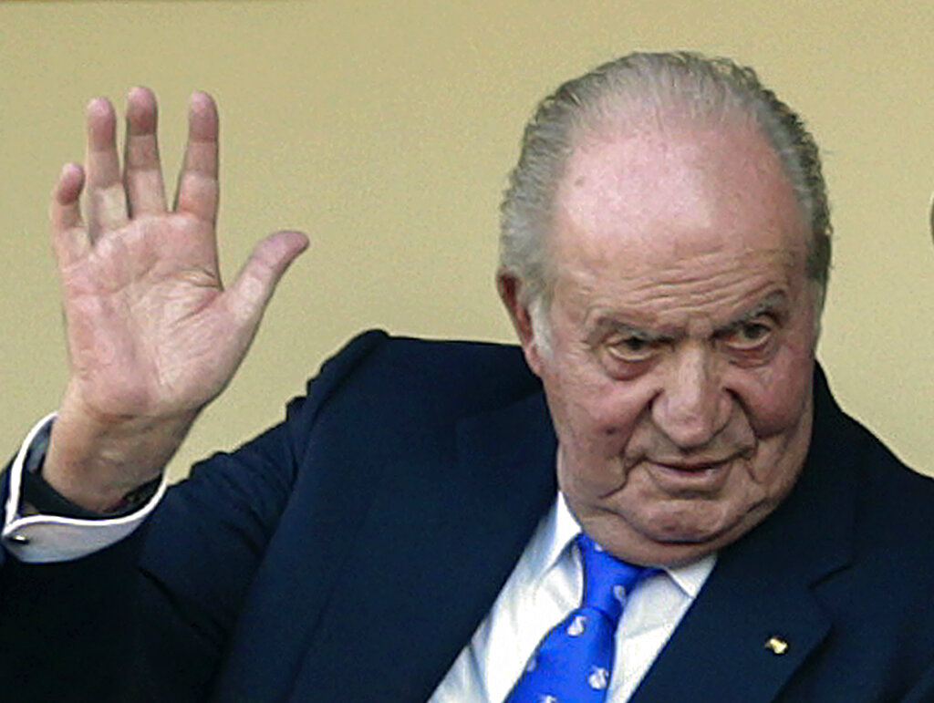 FILE - In this file photo dated Sunday, June 2, 2019, Spain's former King Juan Carlos waves at the bullring in Aranjuez, Spain.  The royal family's website on Monday Aug. 3, 2020, published a letter from Spain's former monarch, King Juan Carlos I, saying he is leaving Spain to live in another country, amidst a financial scandal.   (AP Photo/Andrea Comas, FILE)