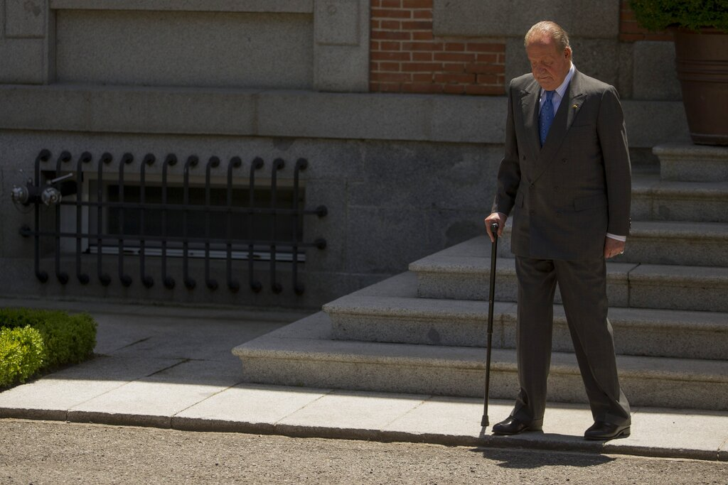 FILE - In this June 9, 2014 file photo then Spanish King Juan Carlos, looks down as he waits for Mexico's President Enrique Pena Nieto, at the Zarzuela Palace, near Madrid. The royal family's website on Monday Aug. 3, 2020, published a letter from Spain's former monarch, King Juan Carlos I, saying he is leaving Spain to live in another country, amidst a financial scandal. (AP Photo/Andres Kudacki, File)
