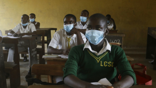 "File---File picture taken Aug.4, 2020 shows students from Lagos State Model School wearing face mask to protect against coronavirus attend lectures inside a class room in Lagos, Nigeria. Nigeria officials resumed both public and private schools on Monday for students following months of closure to curb the spread of coronavirus. As Germany's 16 states start sending millions of children back to school in the middle of the global coronavirus pandemic, those used to the country's famous ""Ordnung"" are instead looking at uncertainty, with a hodgepodge of regional regulations that officials acknowledge may or may not work. (AP Photo/Sunday Alamba, File)"