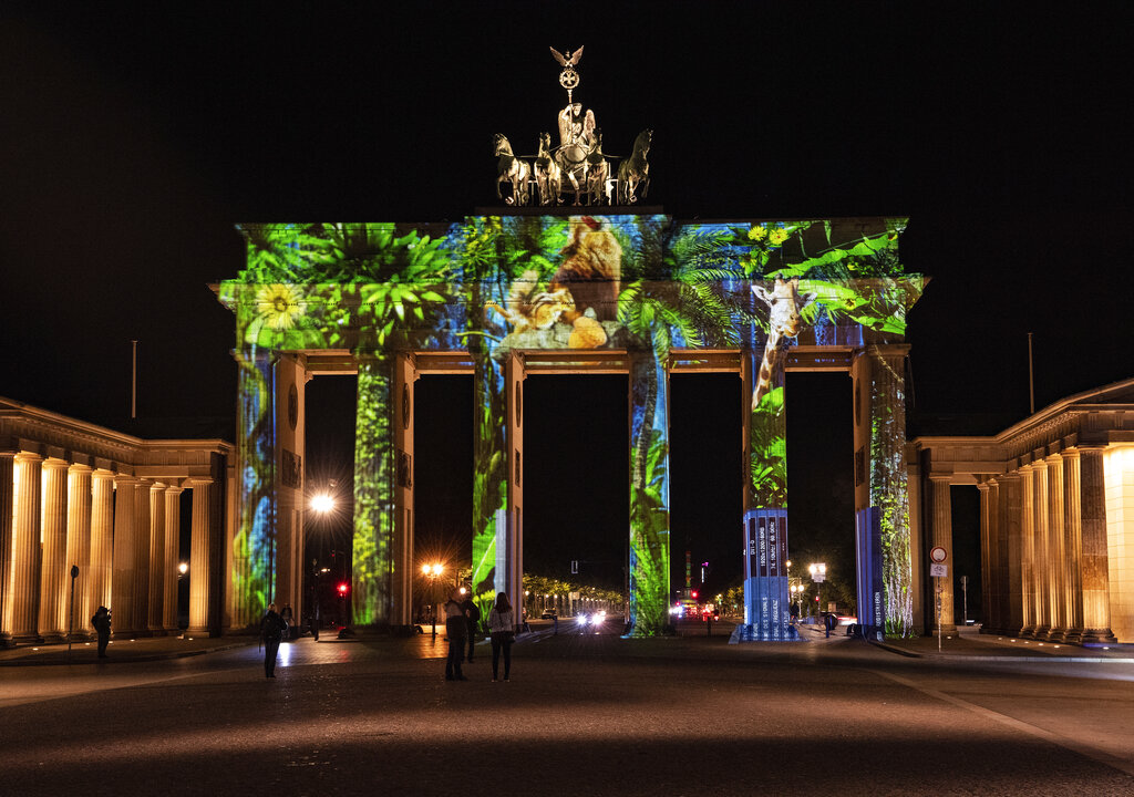 The Brandenburg Gate is illuminated during rehearsal on the eve of the 'Festival of Lights' in Berlin, Germany, Thursday, Sept. 10, 2020. Some of Berlin's most famous landmarks and buildings will be glowing and sparkling with various colours and types of light and projections during the festival, which runs from Friday Sept. 11 until Sunday, Sept. 20, 2020, at the German capital.Paul Zinken/dpa via AP)