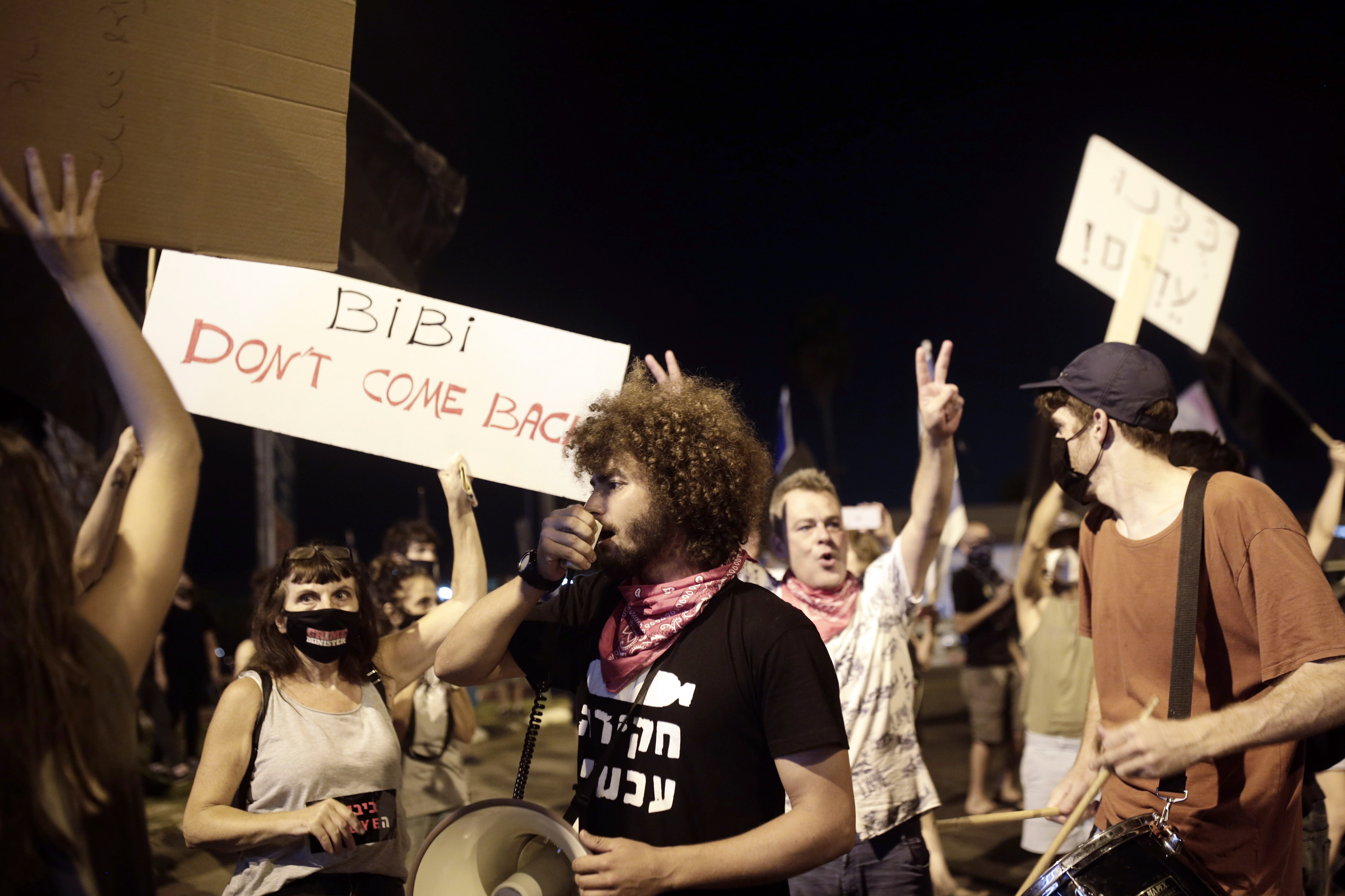 Protesters block an entrance to Ben Gurion Airport where Prime Minister Benjamin Netanyahu and his family are expected to fly with an Israeli delegation to the U.S. for a ceremony with the United Arab Emirates, in Tel Aviv, Sunday, Sept. 13, 2020. (AP Photo/Maya Alleruzzo)