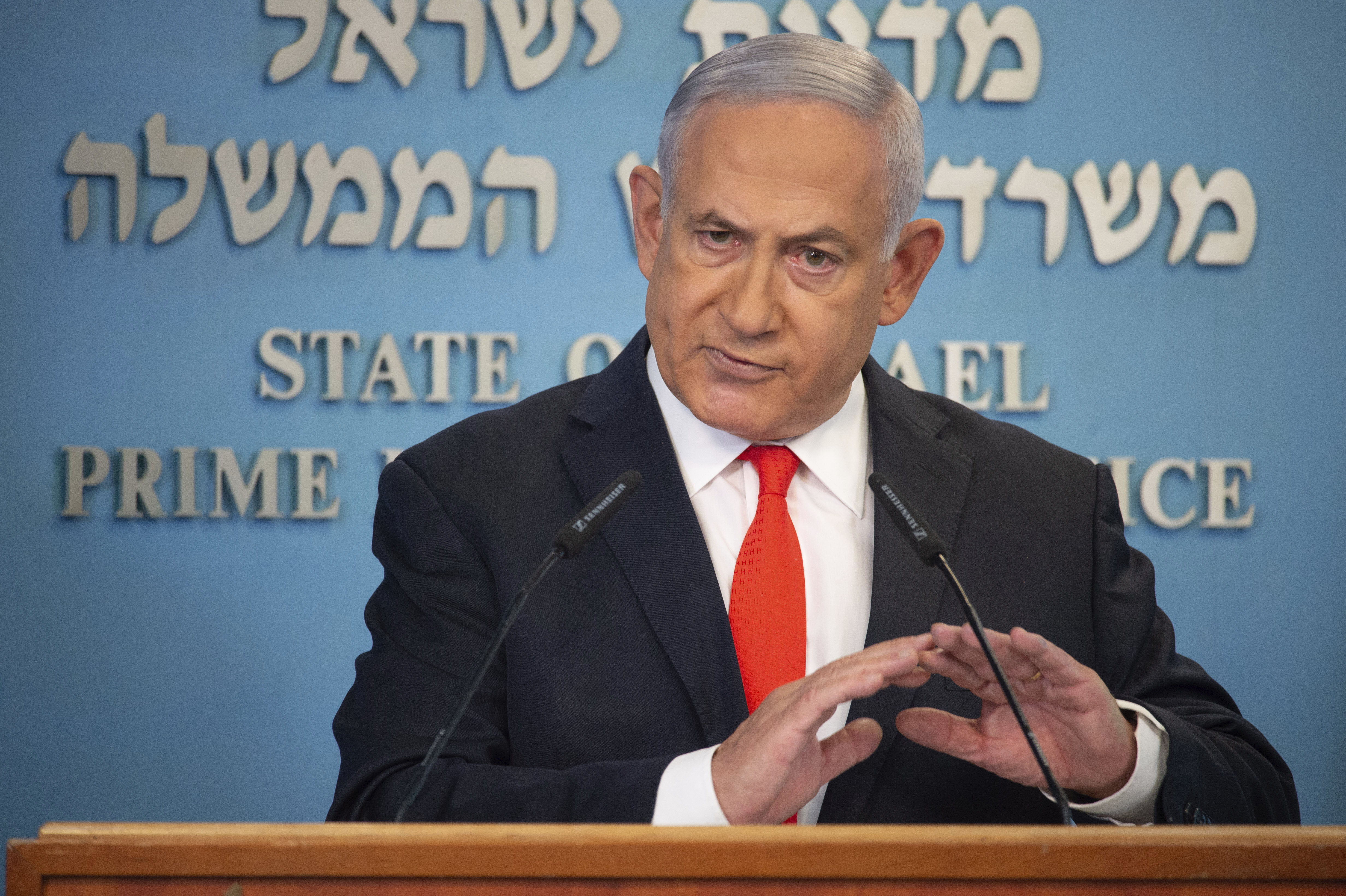 Israeli Prime Minister Benjamin Netanyahu speaks during a briefing on coronavirus development in Israel at his office in Jerusalem, Sunday, Sept. 13 2020. Netanyahu announced a new countrywide lockdown will be imposed amid a stubborn surge in coronavirus cases, with schools and parts of the economy expected to shut down in a bid to bring down infection rates. (Alex Kolomiensky/Yedioth Ahronoth/Pool via AP)