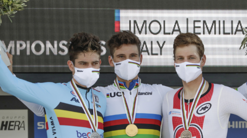 Italy's Filippo Ganna, center, winner of the men's Individual Time Trial event, poses on the podium with second placed Belgium's Wout van Aert, left, and third placed Switzerland's Stefan Kung, at the road cycling World Championships, in Imola, Italy, Friday, Sept. 25, 2020. (AP Photo/Andrew Medichini)