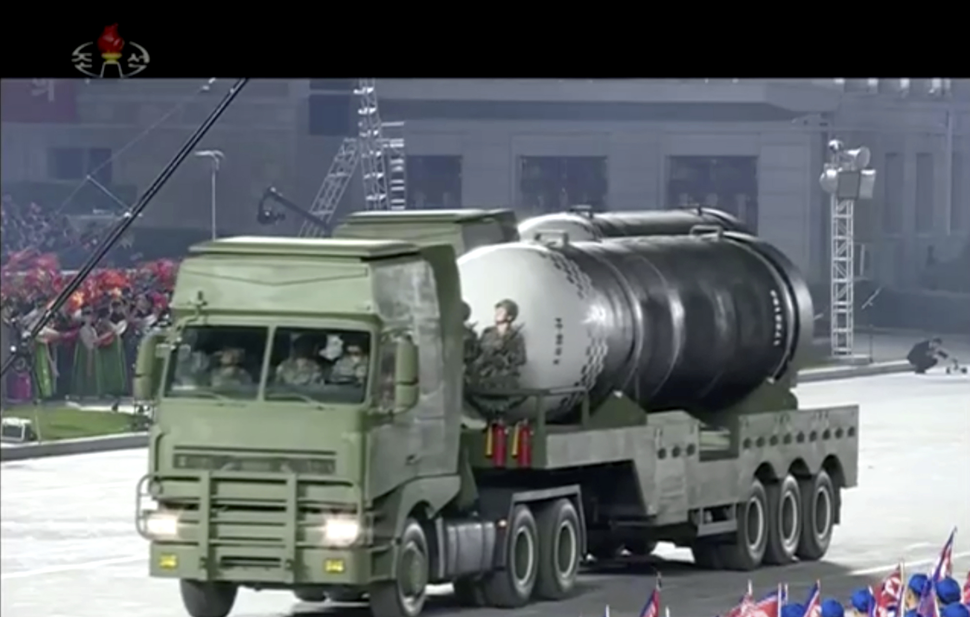 """This image made from video broadcasted by North Korea's KRT, shows a military parade with what appears to be a possible new solid-fuel missile at the Kim Il Sung Square in Pyongyang, Saturday, Oct. 10, 2020. North Korean leader Kim Jong Un warned Saturday that his country would """"fully mobilize"""" its nuclear force if threatened as he took center stage at a massive military parade to mark the 75th anniversary of the country's ruling party. (KRT via AP)"""