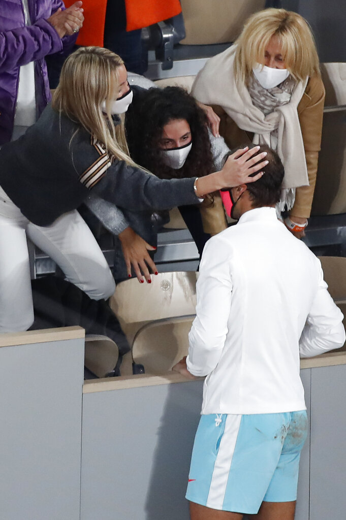 Spain's Rafael Nadal's wife, left, touches his head as he celebrates with family members winning the final match of the French Open tennis tournament against Serbia's Novak Djokovic in three sets, 6-0, 6-2, 7-5, at the Roland Garros stadium in Paris, France, Sunday, Oct. 11, 2020. (AP Photo/Alessandra Tarantino)