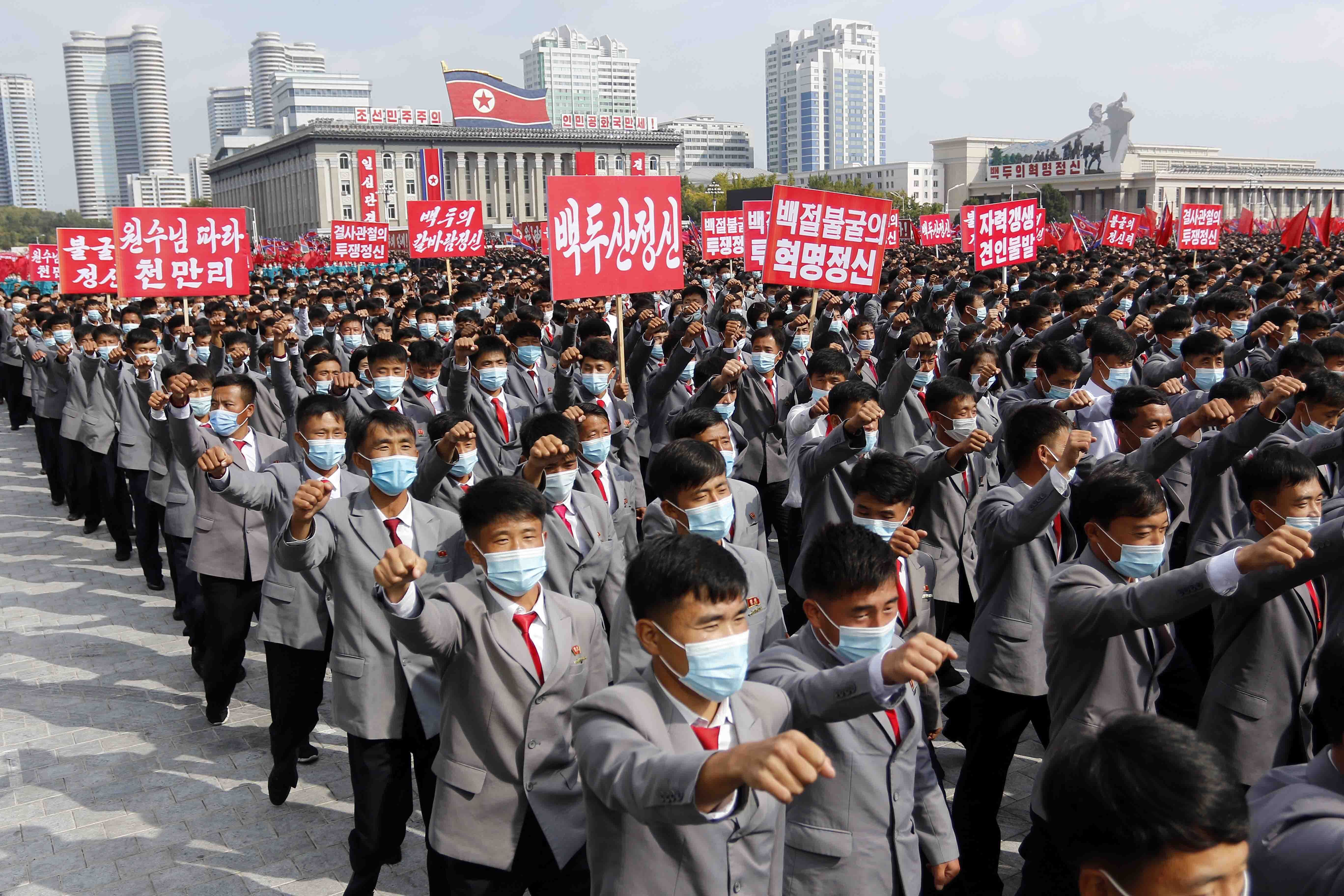Thousands rally to welcome the 8th Congress of the Workers' Party of Korea in the Party at Kim Il Sung Square in Pyongyang, North Korea, Monday, Oct. 12, 2020. (AP Photo/Jon Chol Jin)
