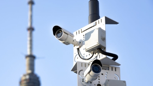 In this photo taken on Saturday, Feb. 22, 2020, two surveillance camera are seen in a street in Moscow, Russia. Moscow's city officials announced a slew of policies aimed at tracking down the few Chinese nationals remaining in the city, including raids on hotels and the use of facial recognition technology to target people evading quarantine. (AP Photo/Alexander Zemlianichenko)