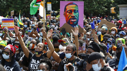 FILE - In this June 14, 2020, file photo, people participate in a Caribbean-led Black Lives Matter rally at Brooklyn's Grand Army Plaza in New York. Amnesty International is calling on New York City and state officials to ban law enforcement from using facial recognition technology, used to spy on Black Lives Matter protesters, saying it threatens the civil rights of