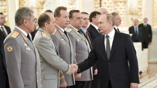 Russian President Vladimir Putin, right, shakes hands with Alexander Bortnikov, head of the Federal Security Service (FSB), second left, as he arrives to attend a meeting with top military and law enforcement officials in the Kremlin in Moscow, Russia, Thursday, April 11, 2019. (Alexei Nikolsky, Sputnik, Kremlin Pool Photo via AP)
