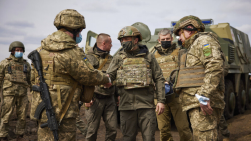 Ukrainian President Volodymyr Zelenskiy shakes hands woth a soldier as he visits the war-hit Donbas region, eastern Ukraine, Thursday, April 8, 2021. Ukraine's president is visiting the area of conflict in his country's east amid an escalation of tensions that has raised fears of a resumption of large-scale hostilities. (Ukrainian Presidential Press Office via AP)