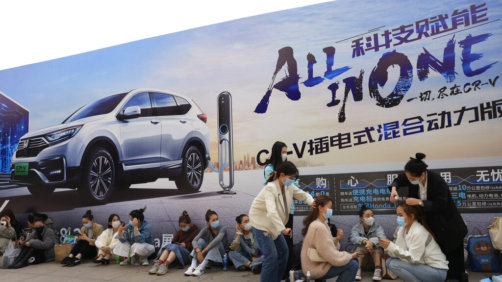 Women have their hair styled ahead of the Auto Shanghai 2021 show in Shanghai on Sunday, April 18, 2021. Automakers from around the world are showcasing their latest products this week in the world's biggest market for auto vehicles. (AP Photo/Ng Han Guan)