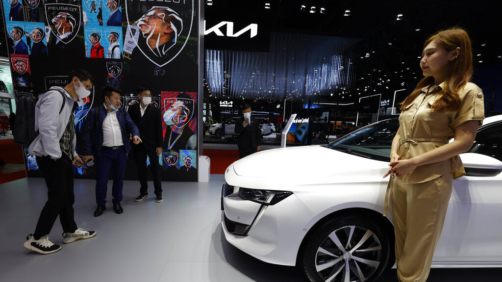 Visitors look at the latest cars on display during the Shanghai Auto Show in Shanghai on Monday, April 19, 2021. Automakers are looking to China, their biggest market by sales volume and the first major economy to rebound from the pandemic, to revive sales and reverse multibillion-dollar losses. (AP Photo/Ng Han Guan)