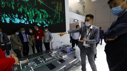 A worker introduces the Huawei Intelligent Car Solution displayed during the Shanghai Auto Show in Shanghai on Monday, April 19, 2021. Automakers are looking to China, their biggest market by sales volume and the first major economy to rebound from the pandemic, to revive sales and reverse multibillion-dollar losses. (AP Photo/Ng Han Guan)