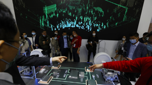 Visitors look at the Huawei Intelligent Car Solution displayed during the Shanghai Auto Show in Shanghai on Monday, April 19, 2021. Automakers are looking to China, their biggest market by sales volume and the first major economy to rebound from the pandemic, to revive sales and reverse multibillion-dollar losses. (AP Photo/Ng Han Guan)