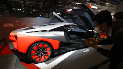 A visitor looks at the BMW Vision Next concept car displayed during the Shanghai Auto Show in Shanghai on Monday, April 19, 2021. Automakers are looking to China, their biggest market by sales volume and the first major economy to rebound from the pandemic, to revive sales and reverse multibillion-dollar losses. (AP Photo/Ng Han Guan)