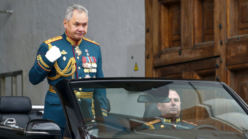 Russian Defense Minister Sergei Shoigu crosses himself was he drives to attend the Victory Day military parade in Red Square in Moscow, Russia, Sunday, May 9, 2021, marking the 76th anniversary of the end of World War II in Europe. Russian President Vladimir Putin marked the anniversary of the end of World War II in Europe with a speech warning that Nazi beliefs remain strong. (AP Photo/Alexander Zemlianichenko)