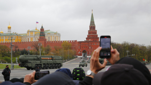 People watch and photograph as a Russian RS-24 Yars ballistic missile rolls past the Kremlin after the Victory Day military parade in Moscow, Russia, Sunday, May 9, 2021, marking the 76th anniversary of the end of World War II in Europe. Russian President Vladimir Putin marked the anniversary of the end of World War II in Europe with a speech warning that Nazi beliefs remain strong. (AP Photo/Alexander Zemlianichenko Jr.)