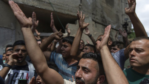Palestinian mourners chant anti Israel slogans during the funeral of Ahmad Shamsa, 15, in the West Bank village of Beta, near Nablus, Thursday, June. 17, 2021. The Palestinian health ministry said Thursday that Shamsa, who was shot by Israeli troops in the West Bank a day earlier, died of his injuries. (AP Photo/Nasser Nasser)
